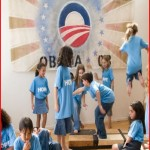 school children sing songs of praise to Obama
