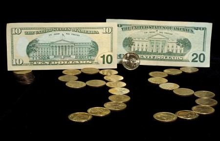 Money Photo by Serge Melki 450x289 Many Of The Largest Charities In America Are Giant Money Making Scams